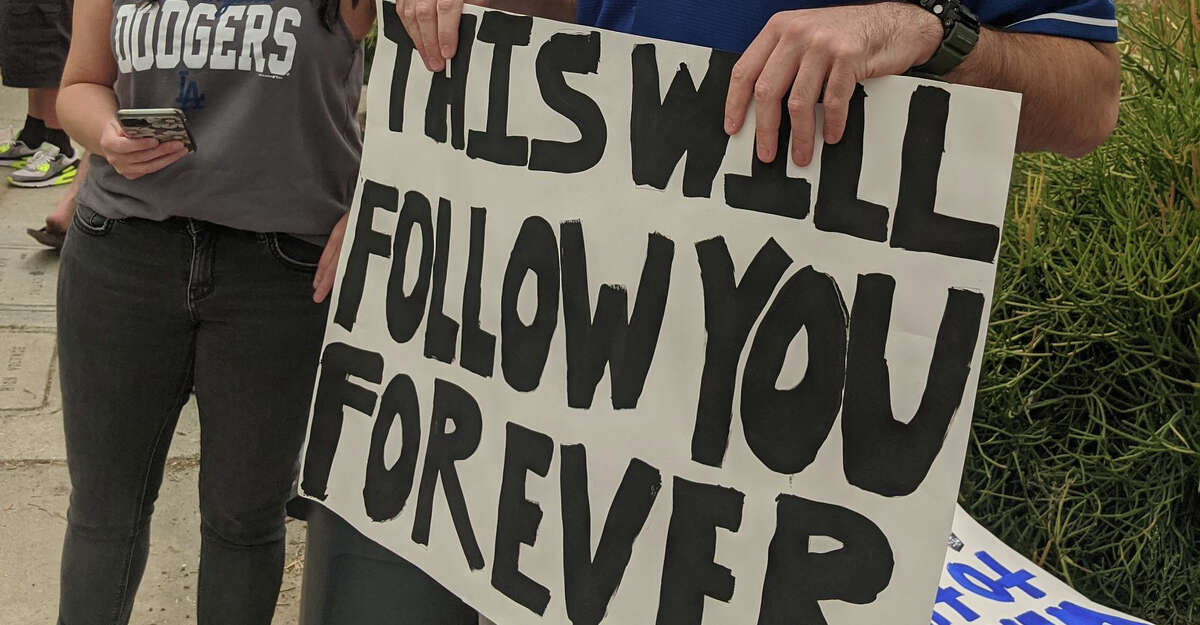 A sign held by a Dodgers fan before the series against the visiting Astros.