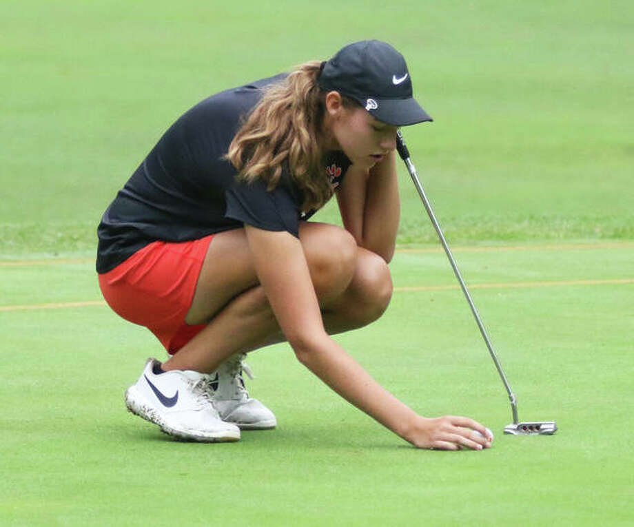 Edwardsville's Nicole Johnson lines up her putt on the first hole Saturday at the Alton Invitational at Rolling Hills Golf Course in Godfrey. Photo: Greg Shashack|Hearst Illinois