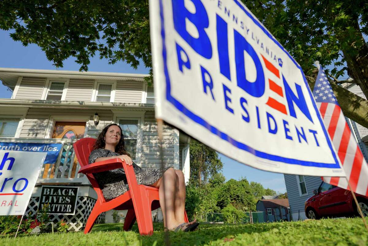 Nin Bell, 47, sits outside her home in Brookhaven, Pa. She regrets voting for Donald Trump in 2016.