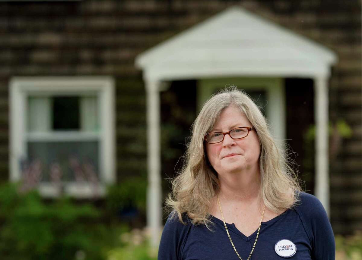 Nora Schreiber McDonough, outside her home in Trevose, Pa., where her family has lived for generations, said she has been at odds with her siblings over politics. She plans to vote for Joe Biden.