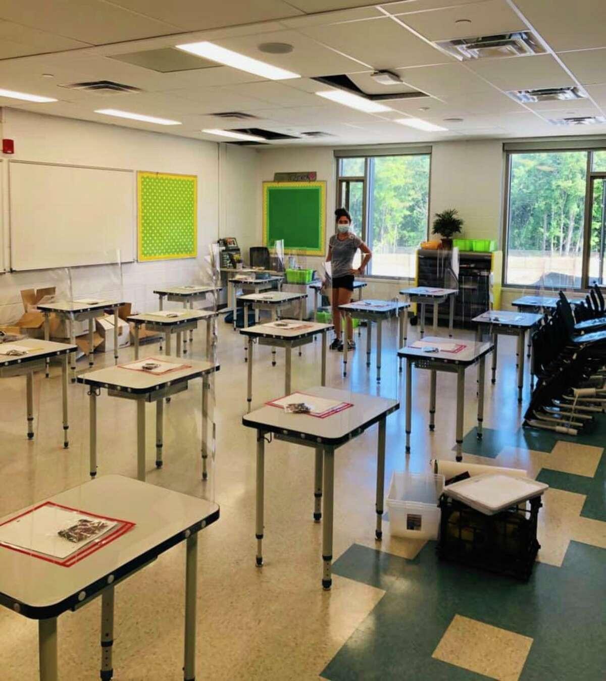 Johnson Elementary School fourth-grade teacher Mrs. Trzcinski gets her classroom ready for students.