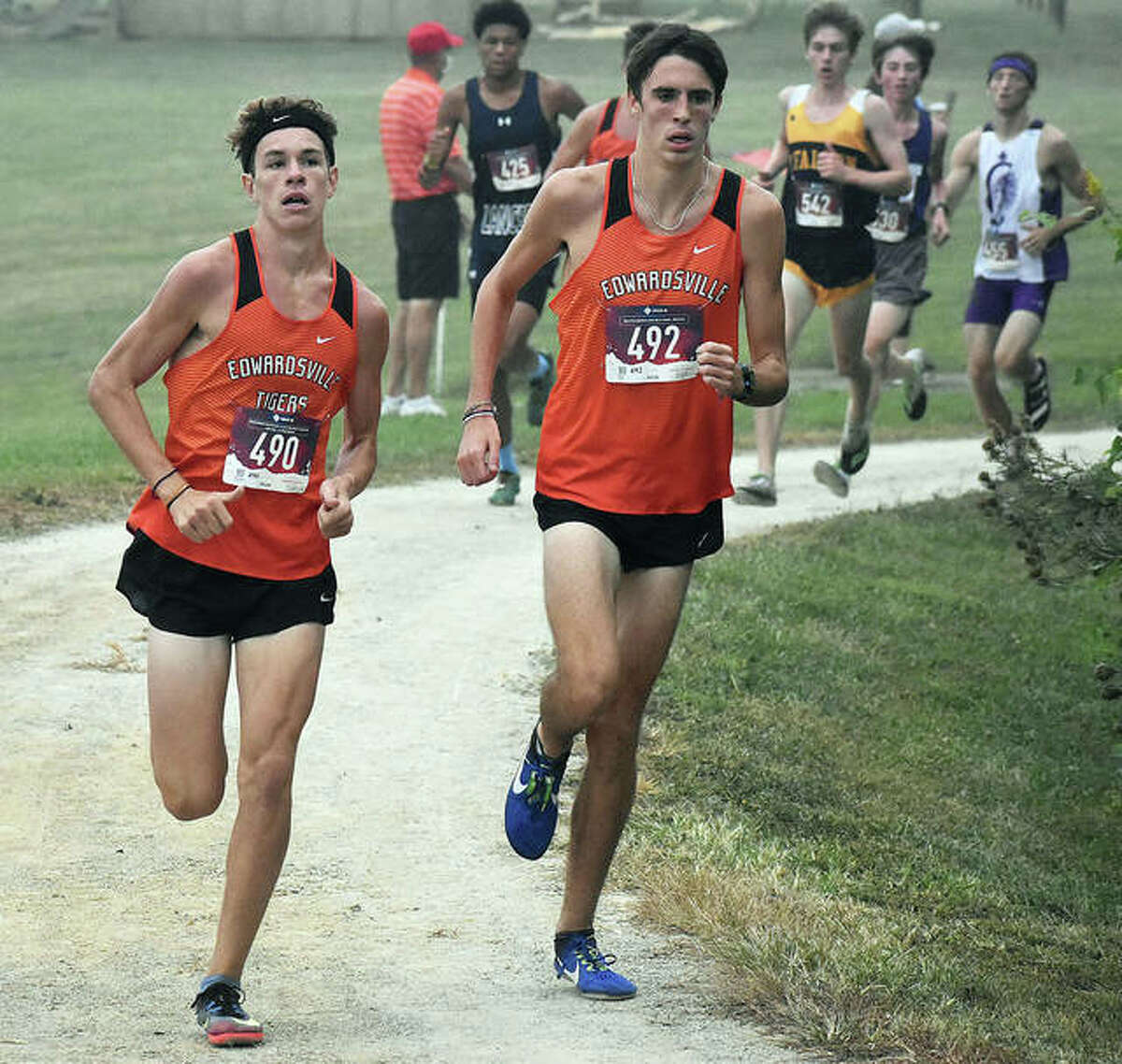 Edwardsville's Ryan Watts (right) and Geordan Patrylak lead a group of runners at Saturday's Belleville West Invite.