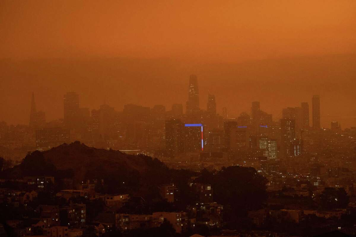 a A view of downtown San Francisco at 11:15 a.m. Wednesday. San Francisco was blanketed in an eerie haze from the wildfires.