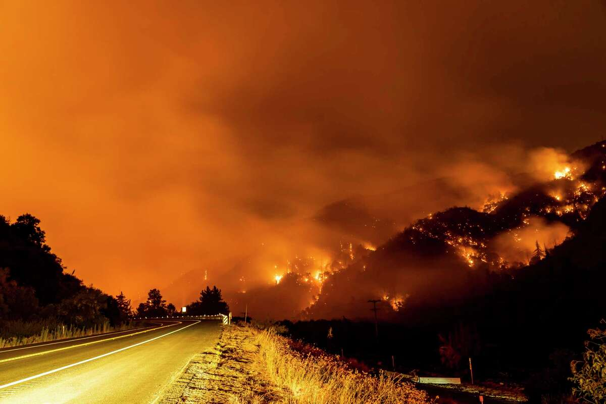 The El Dorado Fire burns a hillside in the San Bernardino National Forest near Yucaipa, Calif., on Wednesday.
