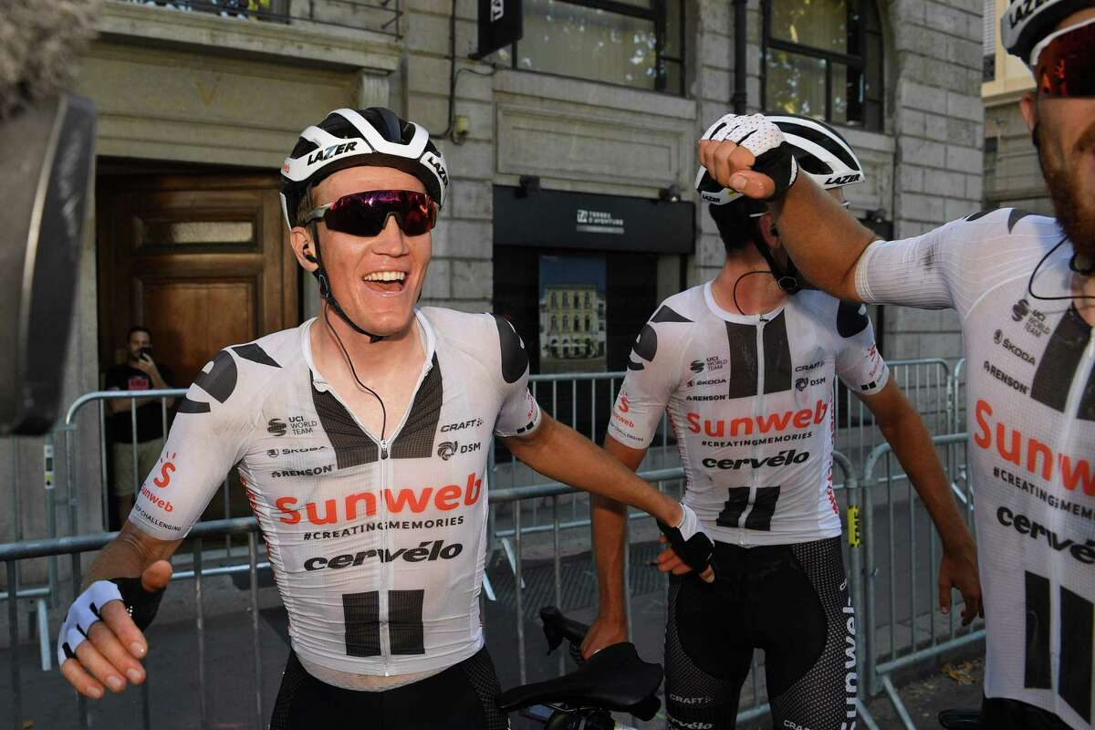 Stage winner Team Sunweb rider Denmark's Soren Kragh Andersen (1st-L) celebrates after crossing the finish line at the end of the 14th stage of the 107th edition of the Tour de France cycling race, 197 km between Clermont-Ferrand and Lyon, on September 12, 2020. (Photo by Franck FAUGERE / POOL / AFP) (Photo by FRANCK FAUGERE/POOL/AFP via Getty Images)