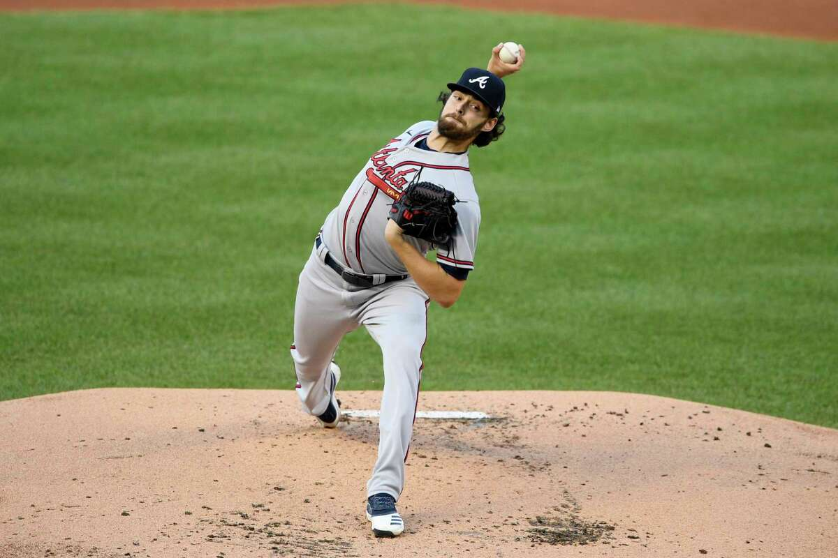 Atlanta Braves starting pitcher Ian Anderson delivers a pitch during the first inning of a baseball game against the Washington Nationals, Saturday, Sept. 12, 2020, in Washington. (AP Photo/Nick Wass)