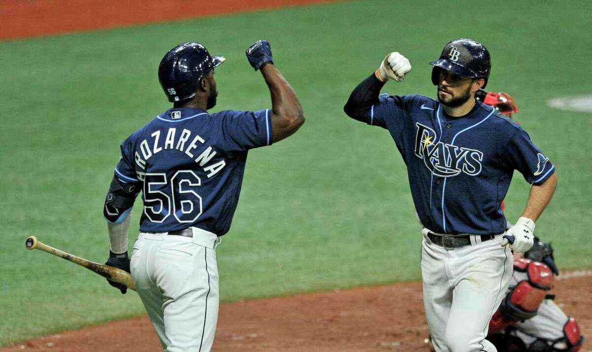 Tampa Bay Rays' Randy Arozarena (56) greets Brandon Lowe after Lowe's solo home run off Boston Red Sox reliever Marcus Walden during the seventh inning of a baseball game Saturday, Sept. 12, 2020, in St. Petersburg, Fla. (AP Photo/Steve Nesius)