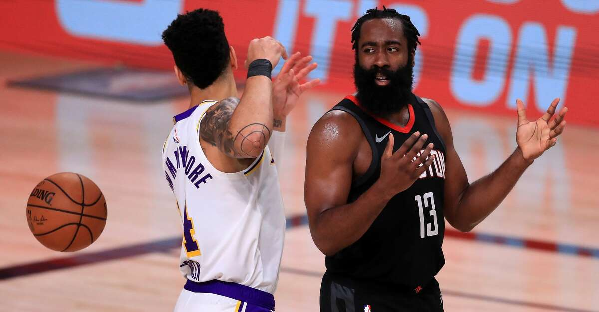 LAKE BUENA VISTA, FLORIDA - SEPTEMBER 12: James Harden #13 of the Houston Rockets reacts with Danny Green #14 of the Los Angeles Lakers during the third quarter in Game Five of the Western Conference Second Round during the 2020 NBA Playoffs at AdventHealth Arena at the ESPN Wide World Of Sports Complex on September 12, 2020 in Lake Buena Vista, Florida. NOTE TO USER: User expressly acknowledges and agrees that, by downloading and or using this photograph, User is consenting to the terms and conditions of the Getty Images License Agreement. (Photo by Michael Reaves/Getty Images)