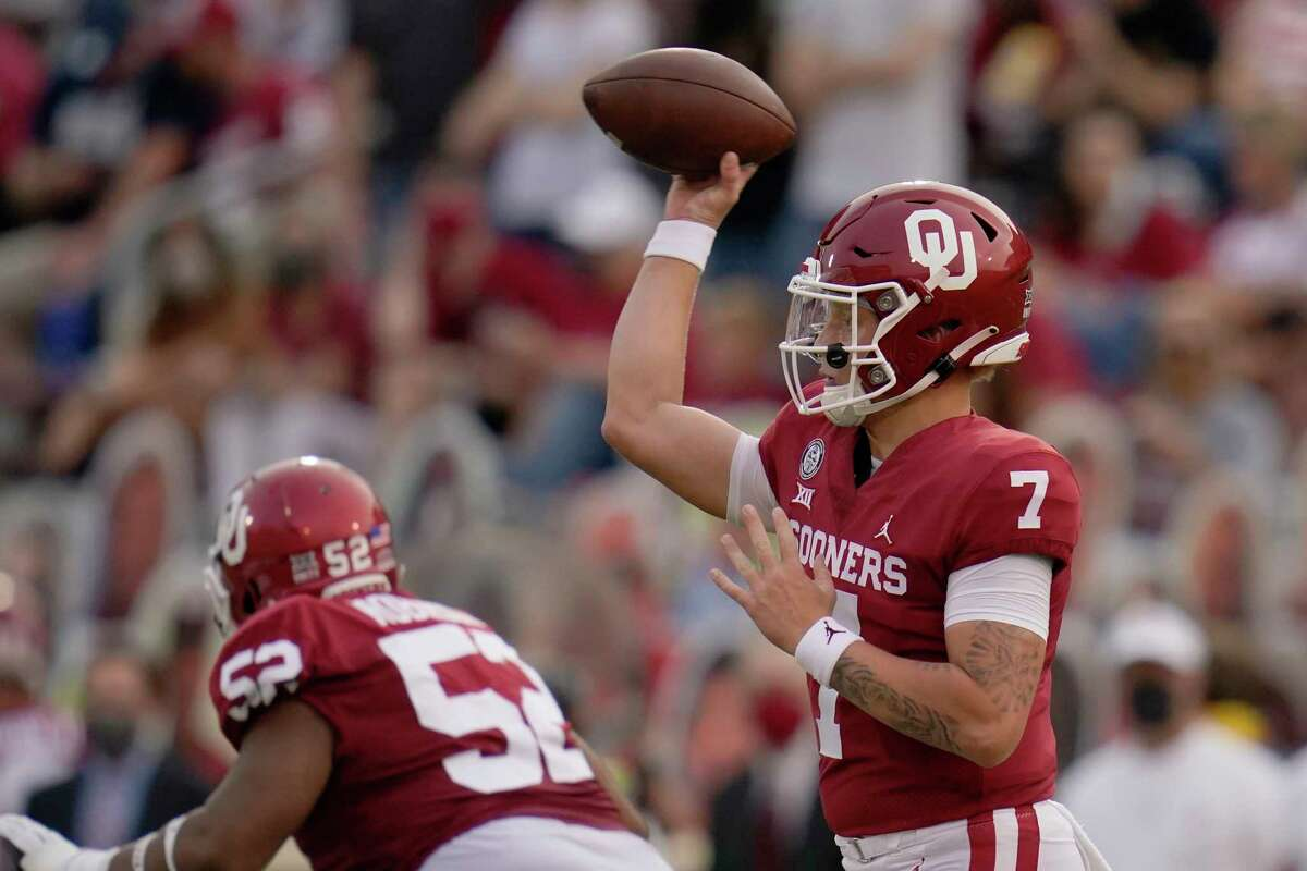 Oklahoma quarterback Spencer Rattler (7) passes in the first half of an NCAA college football game against Missouri State Saturday, Sept. 12, 2020, in Norman, Okla. (AP Photo/Sue Ogrocki, Pool)