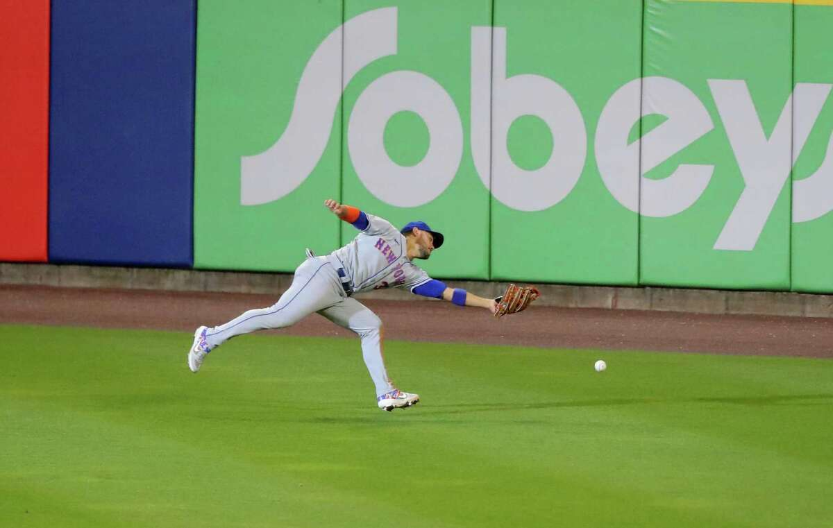BUFFALO, NY - SEPTEMBER 12: Michael Conforto #30 of the New York Mets fails to catch the ball during the sixth inning against the Toronto Blue Jays at Sahlen Field on September 12, 2020 in Buffalo, New York. (Photo by Timothy T Ludwig/Getty Images)