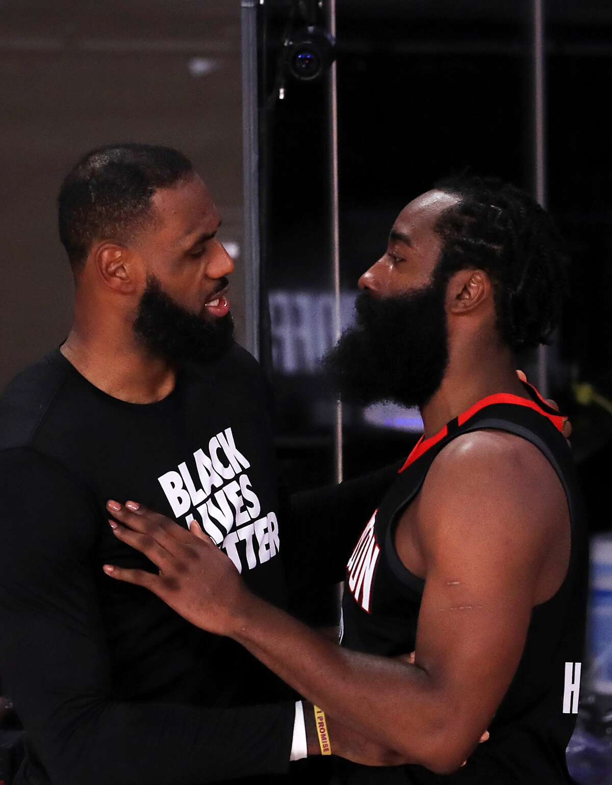 LAKE BUENA VISTA, FLORIDA - SEPTEMBER 12: LeBron James #23 of the Los Angeles Lakers and James Harden #13 of the Houston Rockets react after the Los Angeles Lakers win during the fourth quarter in Game Five of the Western Conference Second Round during the 2020 NBA Playoffs at AdventHealth Arena at the ESPN Wide World Of Sports Complex on September 12, 2020 in Lake Buena Vista, Florida. NOTE TO USER: User expressly acknowledges and agrees that, by downloading and or using this photograph, User is consenting to the terms and conditions of the Getty Images License Agreement. (Photo by Michael Reaves/Getty Images)