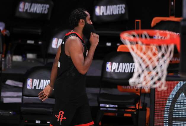 LAKE BUENA VISTA, FLORIDA - SEPTEMBER 12: James Harden #13 of the Houston Rockets exits the court after their loss to Los Angeles Lakers in Game Five of the Western Conference Second Round during the 2020 NBA Playoffs at AdventHealth Arena at the ESPN Wide World Of Sports Complex on September 12, 2020 in Lake Buena Vista, Florida. NOTE TO USER: User expressly acknowledges and agrees that, by downloading and or using this photograph, User is consenting to the terms and conditions of the Getty Images License Agreement. (Photo by Michael Reaves/Getty Images) Photo: Michael Reaves/Getty Images / 2020 Getty Images