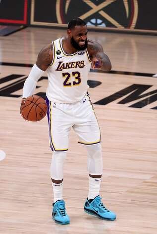 LAKE BUENA VISTA, FLORIDA - SEPTEMBER 12: LeBron James #23 of the Los Angeles Lakers reacts during the third quarter against the Houston Rockets in Game Five of the Western Conference Second Round during the 2020 NBA Playoffs at AdventHealth Arena at the ESPN Wide World Of Sports Complex on September 12, 2020 in Lake Buena Vista, Florida. NOTE TO USER: User expressly acknowledges and agrees that, by downloading and or using this photograph, User is consenting to the terms and conditions of the Getty Images License Agreement. (Photo by Michael Reaves/Getty Images) Photo: Michael Reaves/Getty Images / 2020 Getty Images