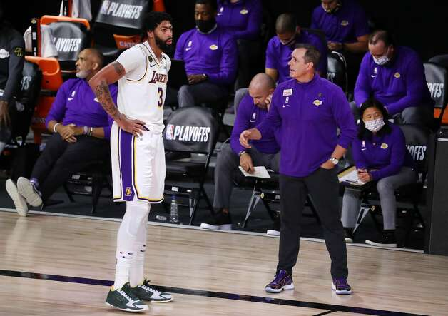 LAKE BUENA VISTA, FLORIDA - SEPTEMBER 12: Anthony Davis #3 of the Los Angeles Lakers talks with Frank Vogel of the Los Angeles Lakers during the third quarter against the Houston Rockets in Game Five of the Western Conference Second Round during the 2020 NBA Playoffs at AdventHealth Arena at the ESPN Wide World Of Sports Complex on September 12, 2020 in Lake Buena Vista, Florida. NOTE TO USER: User expressly acknowledges and agrees that, by downloading and or using this photograph, User is consenting to the terms and conditions of the Getty Images License Agreement. (Photo by Michael Reaves/Getty Images) Photo: Michael Reaves/Getty Images / 2020 Getty Images