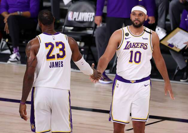 LAKE BUENA VISTA, FLORIDA - SEPTEMBER 12: LeBron James #23 of the Los Angeles Lakers high fives Jared Dudley #10 of the Los Angeles Lakers during the fourth quarter in Game Five of the Western Conference Second Round during the 2020 NBA Playoffs at AdventHealth Arena at the ESPN Wide World Of Sports Complex on September 12, 2020 in Lake Buena Vista, Florida. NOTE TO USER: User expressly acknowledges and agrees that, by downloading and or using this photograph, User is consenting to the terms and conditions of the Getty Images License Agreement. (Photo by Michael Reaves/Getty Images) Photo: Michael Reaves/Getty Images / 2020 Getty Images