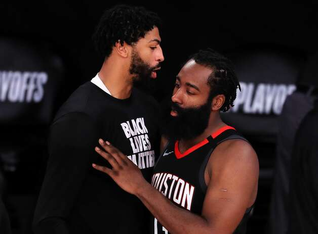 LAKE BUENA VISTA, FLORIDA - SEPTEMBER 12: Anthony Davis #3 of the Los Angeles Lakers and James Harden #13 of the Houston Rockets react after the Los Angeles Lakers win during the fourth quarter in Game Five of the Western Conference Second Round during the 2020 NBA Playoffs at AdventHealth Arena at the ESPN Wide World Of Sports Complex on September 12, 2020 in Lake Buena Vista, Florida. NOTE TO USER: User expressly acknowledges and agrees that, by downloading and or using this photograph, User is consenting to the terms and conditions of the Getty Images License Agreement. (Photo by Michael Reaves/Getty Images) Photo: Michael Reaves/Getty Images / 2020 Getty Images