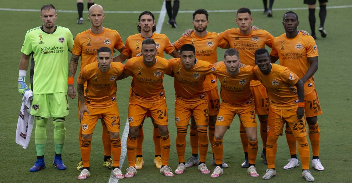 Houston Dynamo starting players take a photos before taking on Minnesota United in a MLS match Wednesday, Sept. 2, 2020, at BBVA Stadium in Houston.