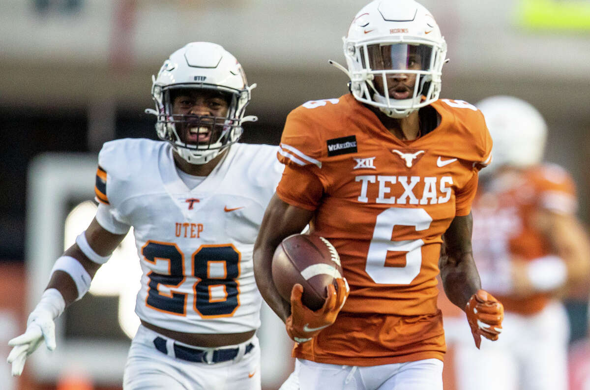Texas' Joshua Moore scored on the first play from scrimmage for the Longhorns with a 78-yard catch and run.
