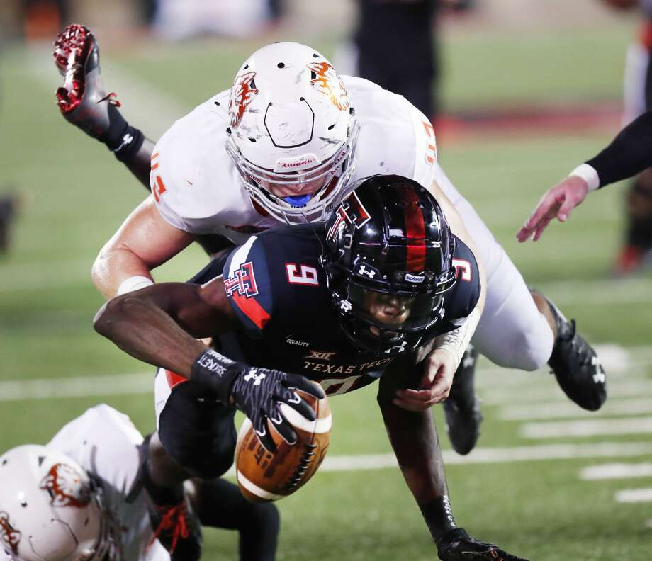 Houston Baptist's Brennan Young, top, tackles Texas Tech's T.J. Vasher (9) on the 1-yard line in the first half of an NCAA college football game, Saturday, Sept. 12, 2020, in Lubbock. Photo: Mark Rogers/Associated Press / Copyright 2020 The Associated Press. All rights reserved