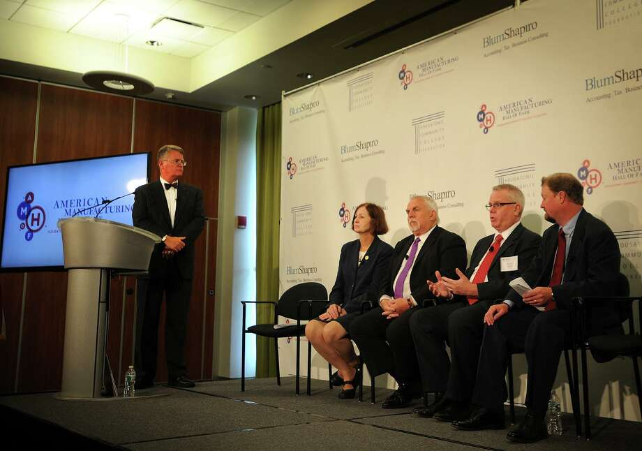 Dan Wisneski, far right, at the opening of the American Manufacturing Hall of Fame at Housatonic Community College in 2014. Wisneski co-chaired the steering committee and was joined on stage by Housatonic Foundation President Chris McCormack, school President Anita Gliniecki, actor and Bridgeport native John Ratzenberger and PEP Lacey President Ken Lisk. Photo: Brian A. Pounds / Brian A. Pounds / Connecticut Post