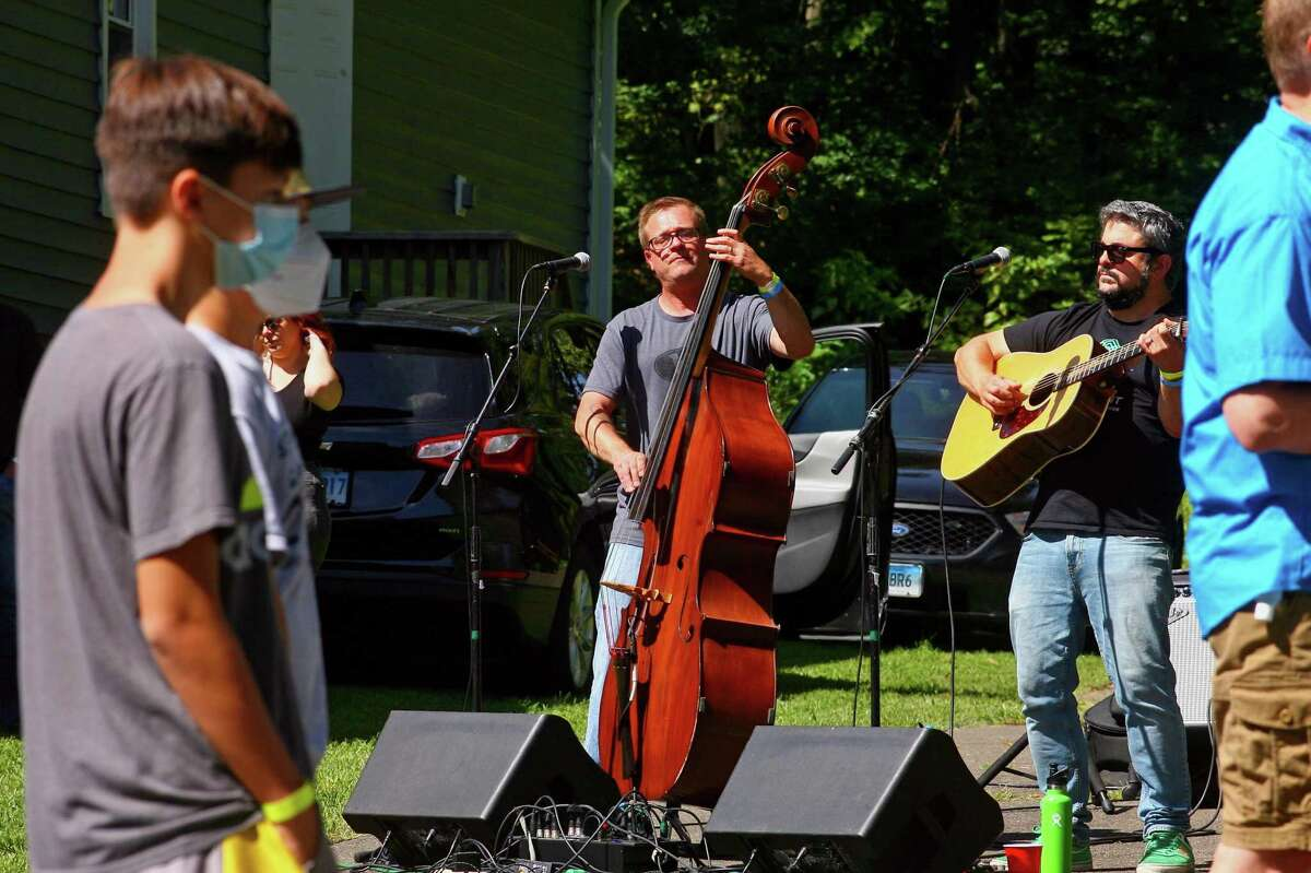 The bluegrass band Hitch and the Giddyup entertains partygoers as Easton celebrates its 175th birthday with its 1st Annual Easton Town Party on the grounds of Ashlar-Aspetuck Masonic Lodge 142 in Easton, Conn., on Saturday Sept. 12, 2020.