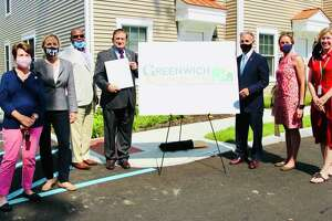 From left, state Rep. Livvy Floren, state Sen. Alex Kasser, Greenwich Communities Executive Director Anthony Johnson, Greenwich Communities Board of Commissioners Chair Sam Romeo, First Selectman Fred Camillo, Selectwoman Jill Oberlander and Selectwoman Lauren Rabin gather at the special ceremony officially changing the name of the Housing Authority of the Town of Greenwich to Greenwich Communities.
