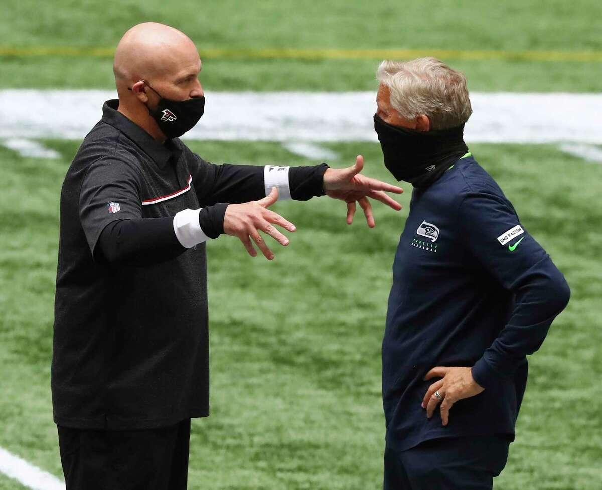 Atlanta Falcons head coach Dan Quinn, left, and Seattle Seahawks head coach Pete Carroll greet each other before an NFL football game at Mercedes-Benz Stadium, Sunday, Sept. 13, 2020, in Atlanta. (Curtis Compton/Atlanta Journal-Constitution via AP)