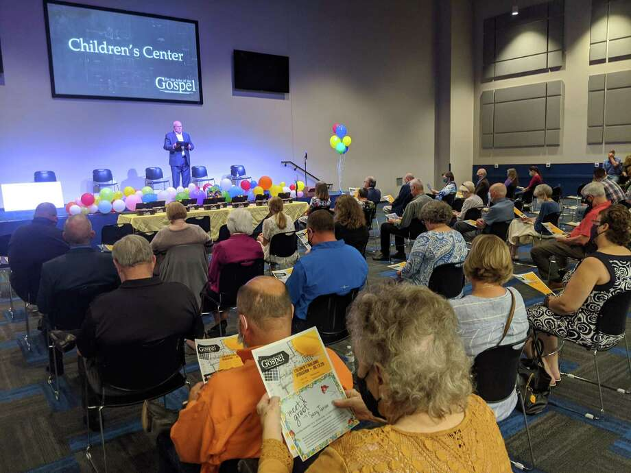 Pastor Jay Gross of West Conroe Baptist Church speaks to his congregation from the worship space in the new children's building. The church celebrated the ribbon cutting of its new children's building on Sunday, Sept. 13. The project was completed early and under budget. Photo: Jamie Swinnerton