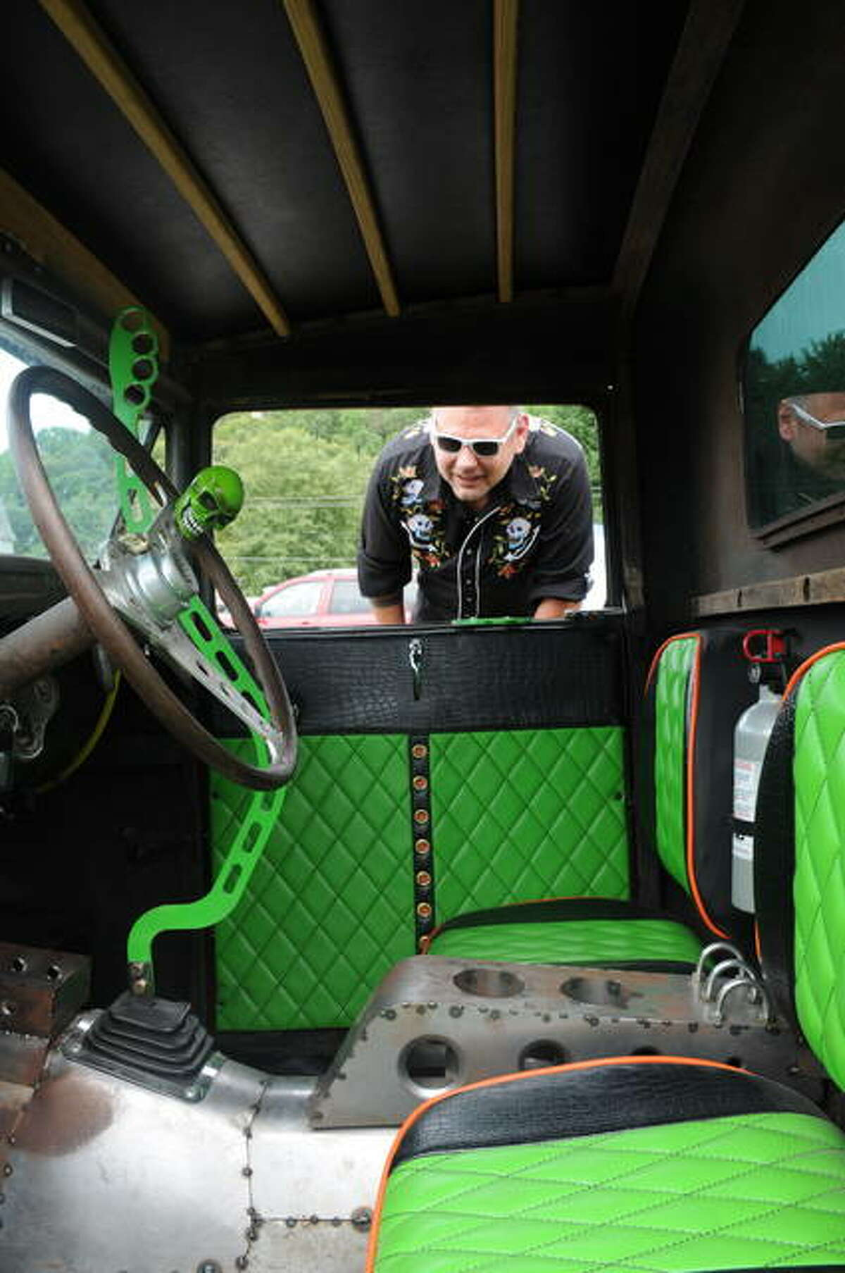 Joe Kozuszek of Belleville admires the interior of an entry in Saturday's Rat Rod Show in Grafton.