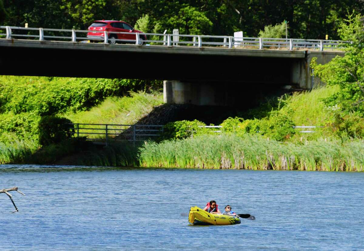 Two people float in a raft on Rensselaer Lake on Sunday, Sept. 13, 2020, in Albany, N.Y. (Paul Buckowski/Times Union)