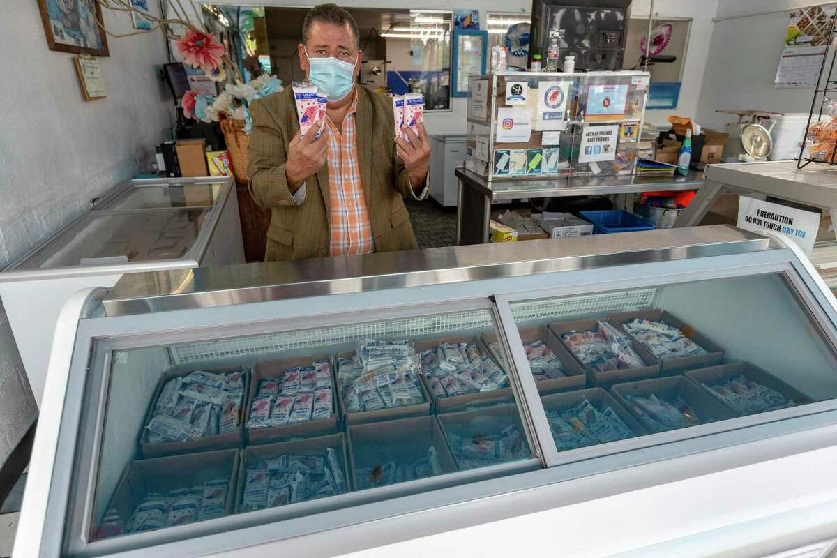El Paraiso owner José Flores stands at a glass display case Thursday, Sept. 10, 2020 at the Fredericksburg Road paleteria he opened in 1984.