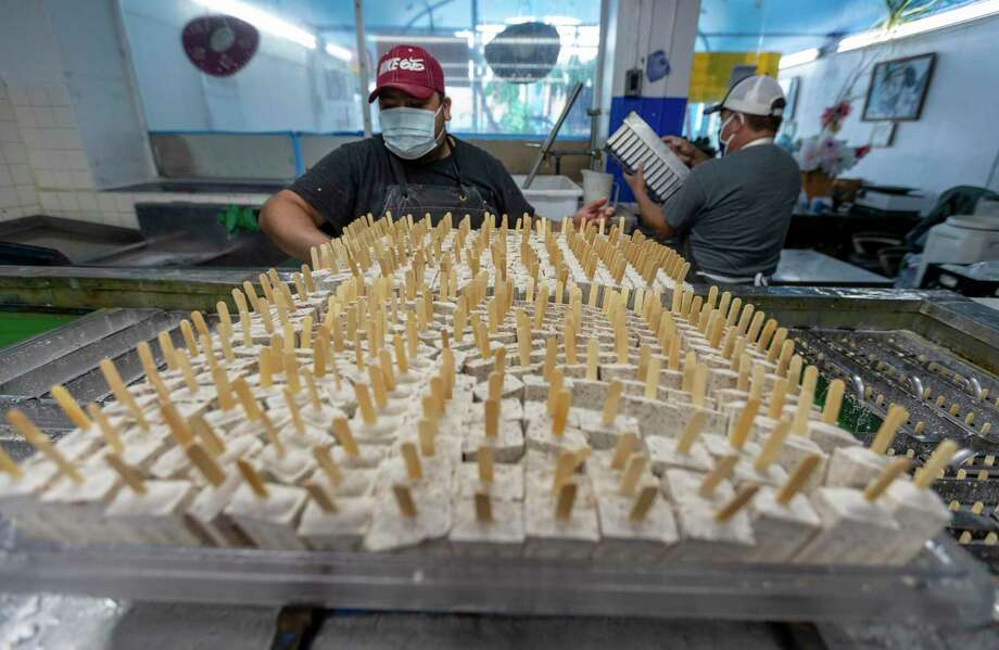Gabriel Tamayo prepares frozen paletas Thursday, Sept. 10, 2020 for packaging at El Paraiso paleteria. Photo: William Luther /Staff / ©2020 San Antonio Express-News