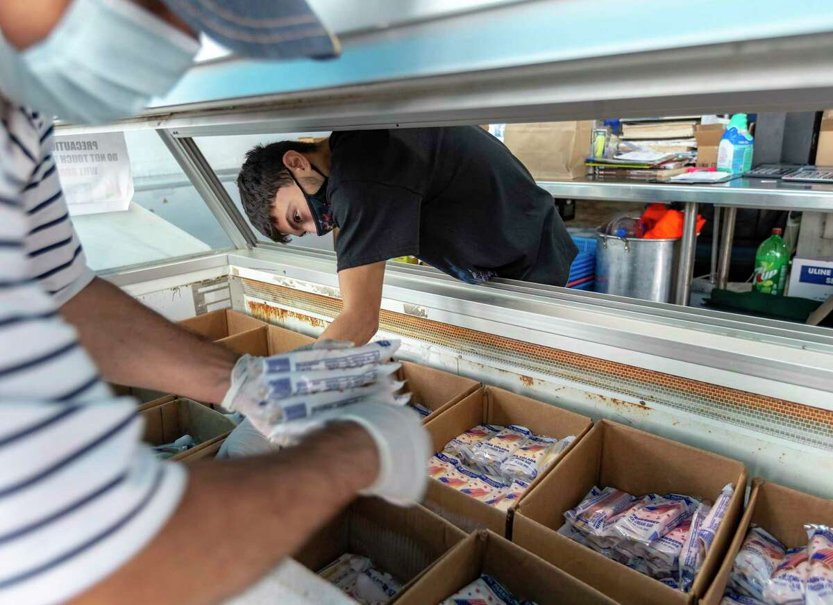 Hector Ramos collects paletas Thursday, Sept. 10, 2020 at El Paraiso paleteria in the 1900 Block of Fredericksburg Road.