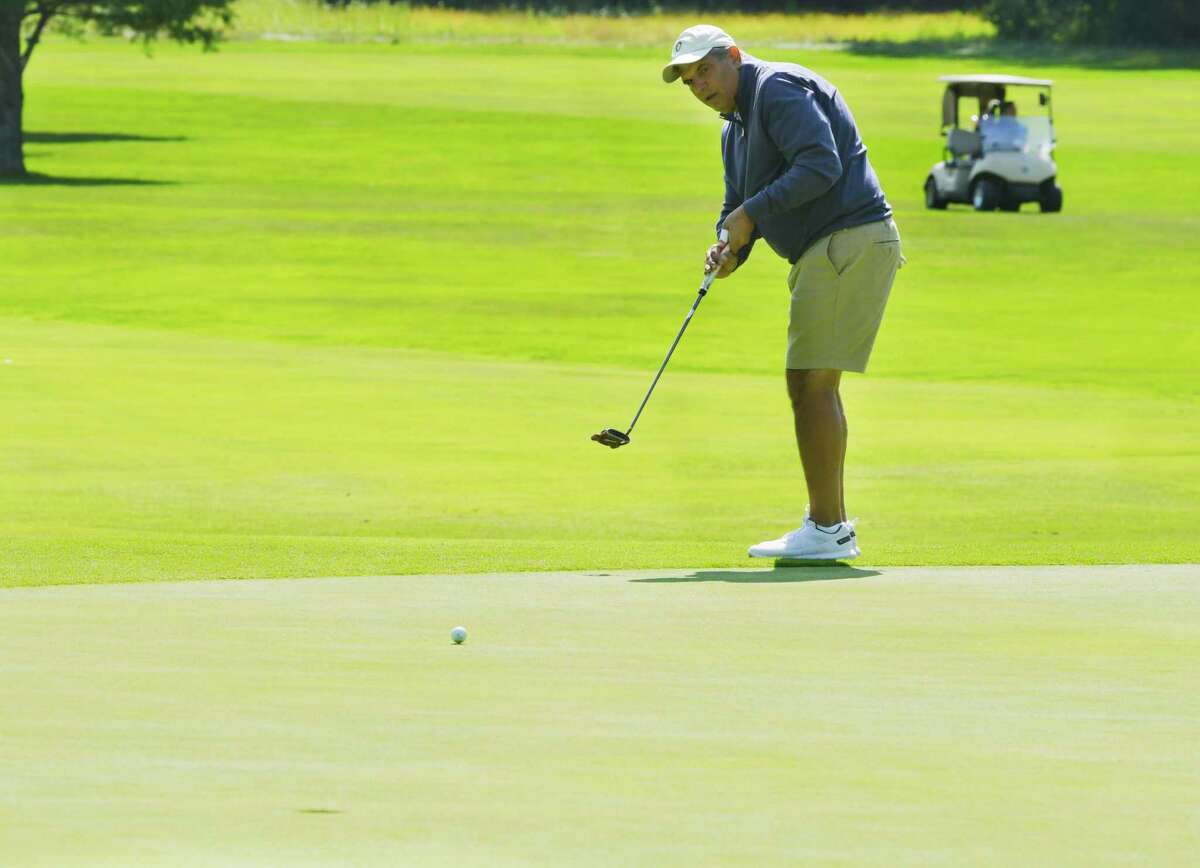 Dan Russo putts on the 18th green during the final round of the Schenectady Classic golf tournament at the Schenectady Municipal Golf Course on Sunday, Sept. 13, 2020, in Schenectady, N.Y. Russo won the event, finishing the round four under par. (Paul Buckowski/Times Union)
