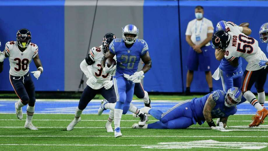 Detroit Lions running back Adrian Peterson (28) runs against the Chicago Bears in the second half of an NFL football game in Detroit, Sunday, Sept. 13, 2020. (AP Photo/Duane Burleson) / Copyright 2020 The Associated Press. All rights reserved