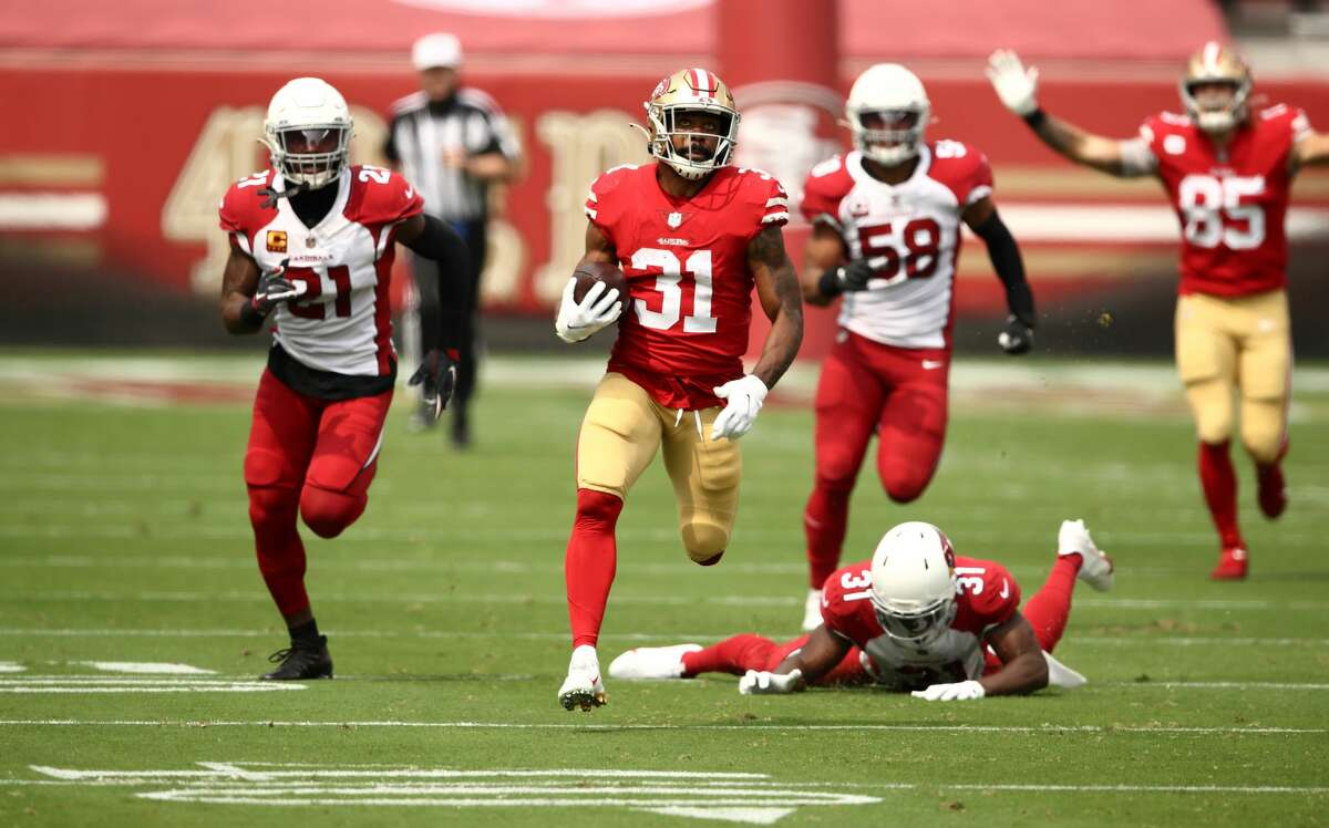 Raheem Mostert #31 of the San Francisco 49ers gets past Chris Banjo #31 of the Arizona Cardinals on his way to a touchdown at Levi's Stadium on September 13, 2020 in Santa Clara, California. (Photo by Ezra Shaw/Getty Images)