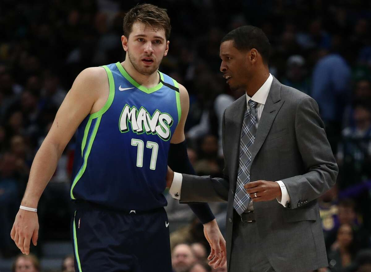 DALLAS, TEXAS - JANUARY 10: Luka Doncic #77 of the Dallas Mavericks and assistant coach Stephen Silas at American Airlines Center on January 10, 2020 in Dallas, Texas. (Photo by Ronald Martinez/Getty Images)