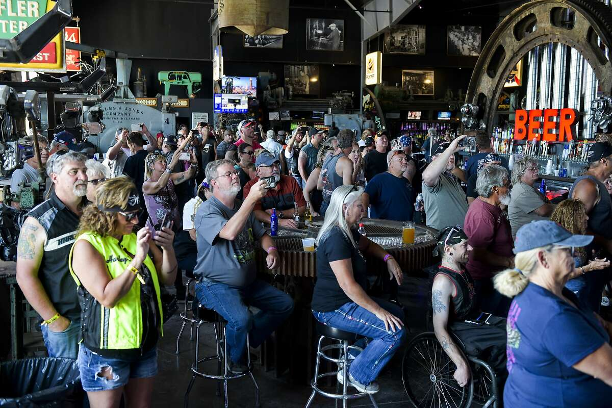 People watch a concert at the Full Throttle Saloon during the 80th Annual Sturgis Motorcycle Rally in Sturgis, South Dakota on August 9, 2020. While the rally usually attracts around 500,000 people, officials estimate that more than 250,000 people may still show up to this year's festival despite the coronavirus pandemic. (Michael Ciaglo/Getty Images/TNS)