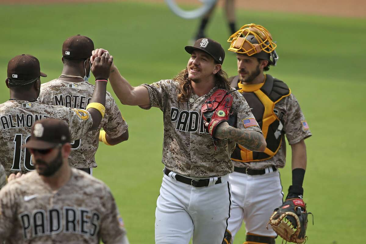 San Diego Padres Mike pitcher Clevinger is congratulated by teammates after beating the San Francisco Giants' in a baseball game Sunday, Sept. 13, 2020, in San Diego. (AP Photo/Derrick Tuskan)
