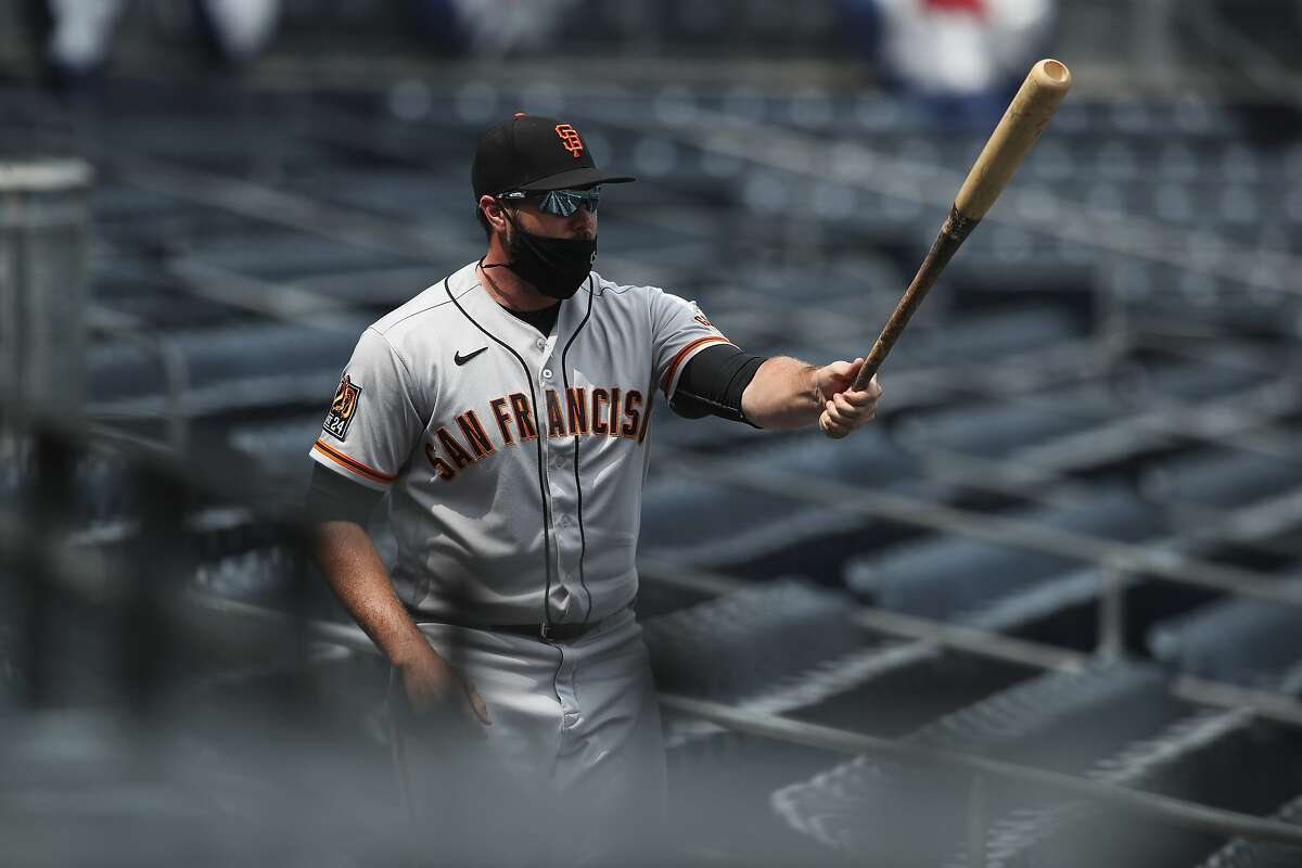 San Francisco Giants Darin Ruf retrieves San Diego Padres Fernando Tatis Jr.s' bat after it went flying into the stands in the first inning of a baseball game Sunday, Sept. 13, 2020, in San Diego. (AP Photo/Derrick Tuskan)