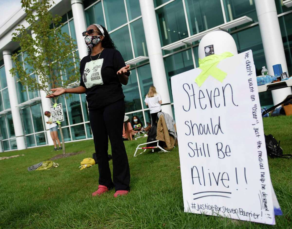 Stephen Barrier's mother Valerie Jaddo protests with the Justice for Stephen Barrier group outside the Stamford Police Department in Stamford, Conn. Sunday, Sept. 13, 2020. The group held a daylong sit-in outside the police station demanding transparency and justice regarding the death of Stephen Barrier, who died in police custody in October of 2019.