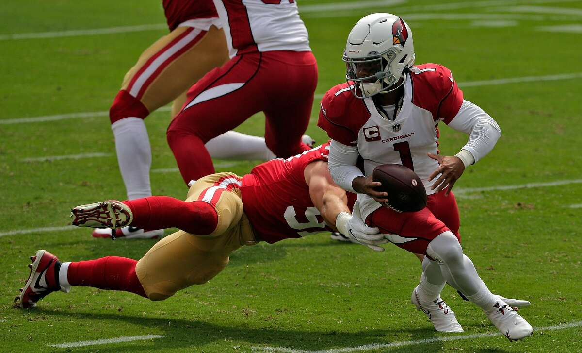 Kyler Murray (1) evades a tackle by Nick Bosa (97) In the first half as the San Francisco 49ers played the Arizona Cardinals at Levi's Stadium in Santa Clara, Calif., on Sunday, September 13, 2020.