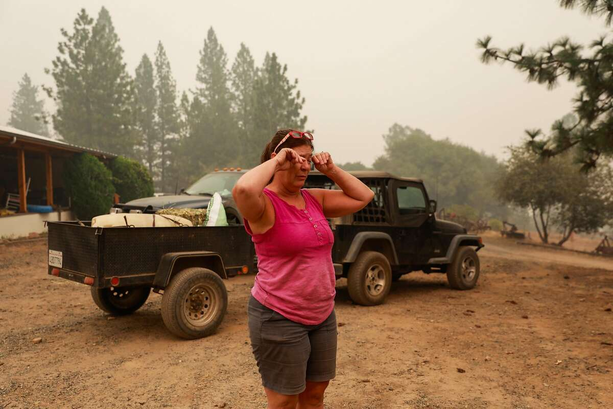 Cathy Shanahan gets emotional at the toll the fire has taken despite her home being safe after the North Complex Fire tore through the area on Sunday, Sept. 13, 2020 in Butte County, California. Cathy did not lose her house but is distraught about the destruction happening to her community