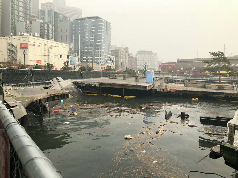 Pier 58 collapsed Sept. 13, 2020. Two construction workers were transported to Harborview Medical Center but didn't have life-threatening injuries, according to a Harborview spokesperson. Photo: Seattle Fire Department