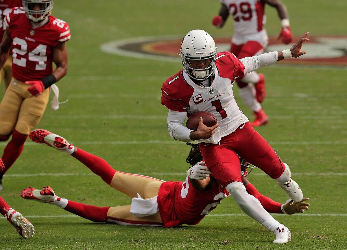 Kyler Murray (1) scrambles evading a tackle by Richard Sherman (25) In the second half as the San Francisco 49ers played the Arizona Cardinals at Levi's Stadium in Santa Clara, Calif., on Sunday, September 13, 2020.
