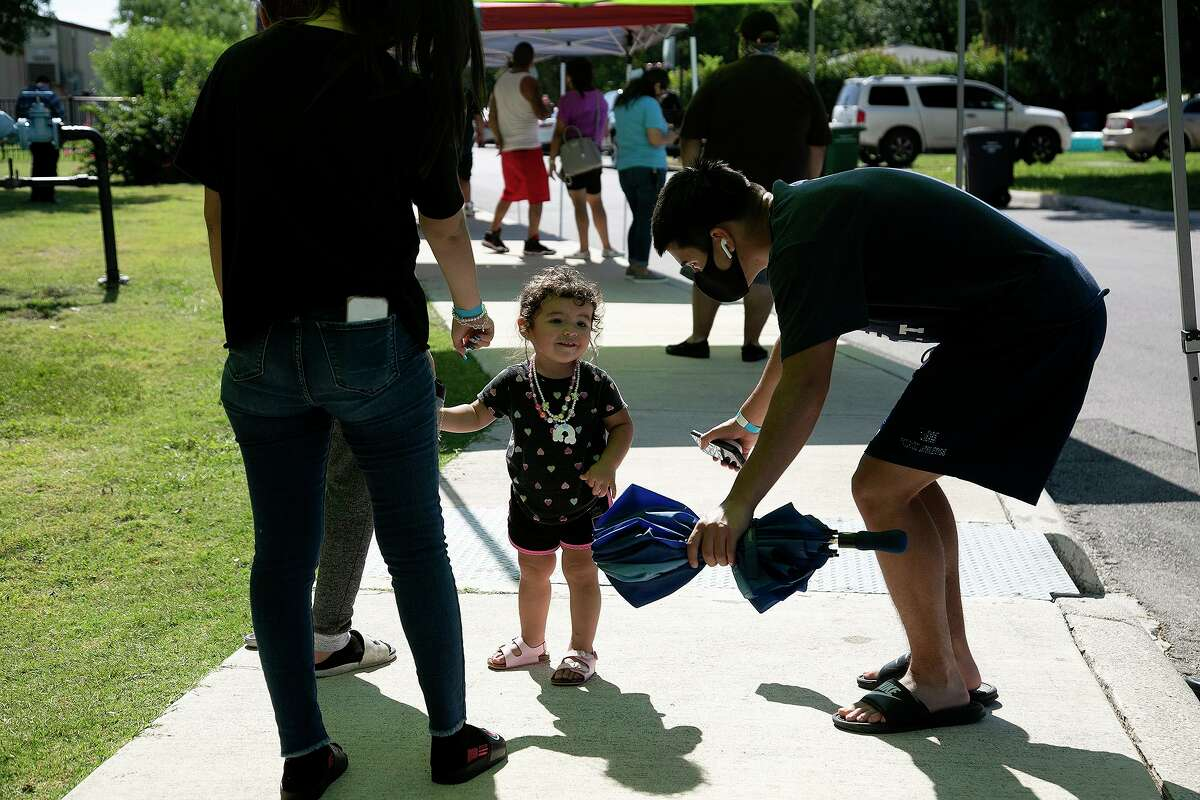 Ryan Lowery entertains his niece, Novalee Gonzales, 1, as they wait in line with family at Will Rogers Academy, a San Antonio Metropolitan Health's COVID-19 walk-up testing site, on June 25. Metro Health offers at least two free walk-up sites every day, changing locations every so often to increase public access to testing. For Sunday, Sept. 13, the two are Cuellar Community Center, 5626 San Fernando Street, and Ramirez Community Center, 1011 Gillette Blvd. The two are open 10 a.m. to 2 p.m. No appointment is needed.