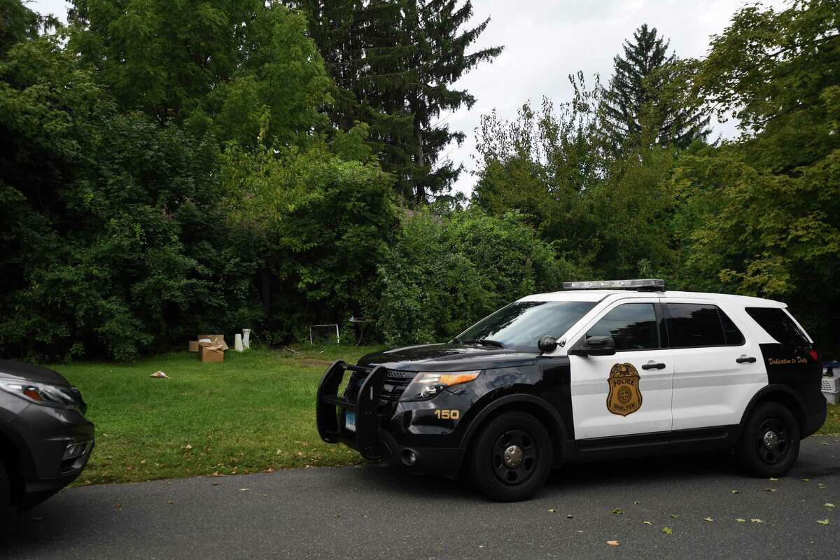 Shelton police are on scene where Gale Lupe, 79, and her son Michael Kramer, 59, were found deceased in their home at 88 Sorghum Road in Shelton, Conn. on Sunday, September 13, 2020. The house is overgrown with vegetation and barely visible from the road.