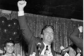 Jerry Jennings, winner of the Albany mayoral Democratic party primary, delivers his acceptance speech at a victory party held at the Washington Inn on Sept. 14, 1993. Jenning's son Jerry Jr., in the background, announced his father to the podium.