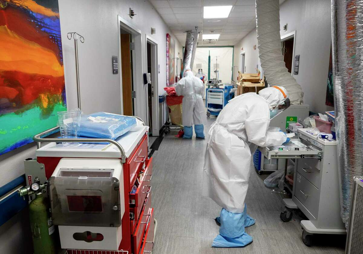 UMMC medical staff works inside one of the COVID-19 intensive care units Thursday, June 11, 2020, in Houston. The state of Texas has seen a spike in COVID-19 cases.
