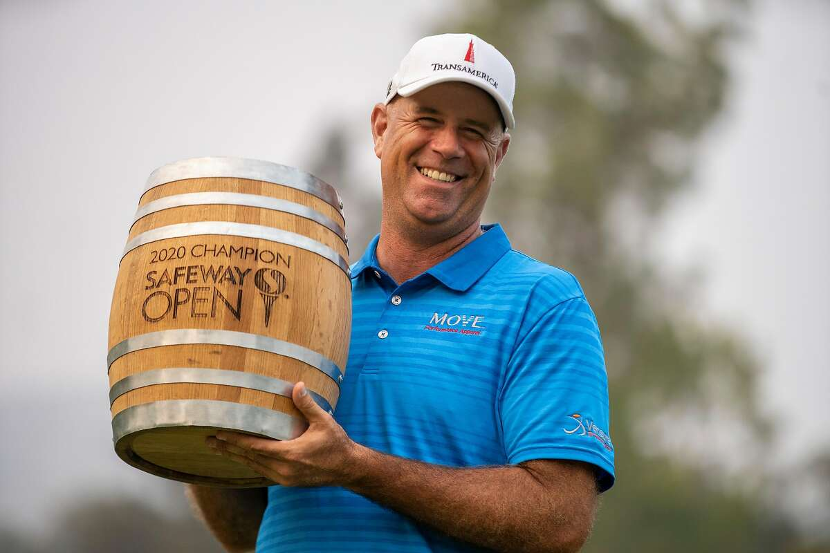 Stewart Cink celebrates with the trophy after winning the Safeway Open golf tournament at the Silverado Resort, Sunday, Sept. 13, 2020, in Napa, Calif.